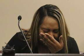 Witness Myra Casas weeps Tuesday. Casas testified that Richard Amezquita forced her to have sex with him when she was pregnant.