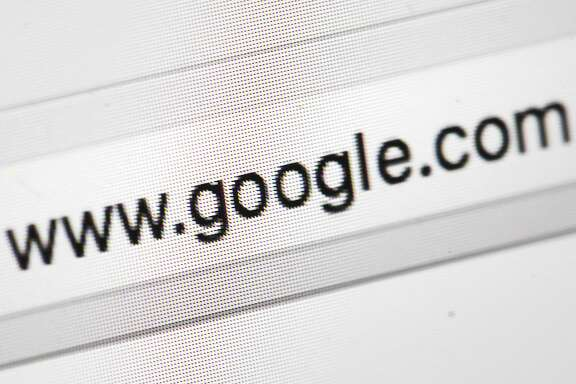 This Wednesday, April 26, 2017, photo shows Google's web address, in Philadelphia. Google is keeping an eye on what you�re buying offline in addition to monitoring your online shopping in its latest attempt to sell more digital advertising. The offline tracking of most credit and debit card transactions will help Google to automatically inform merchants when digital ads appearing on its vast marketing network translate into sales at a brick-and-mortar store. Google plans to unveil the store-sales measurement tool Tuesday, May 23, 2017, in San Francisco at an annual conference it hosts for its advertisers. (AP Photo/Matt Rourke)