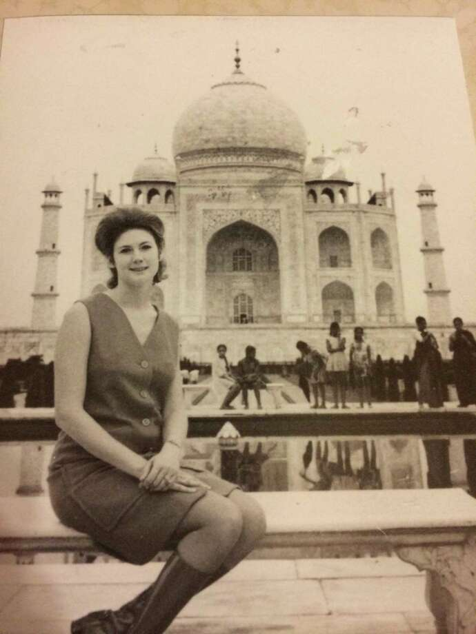 Sandee Mewhinney poses in front of the Taj Mahal in Acra, India, during an around-the-world trip she took in 1969. Photo: Johns, Reader Submission