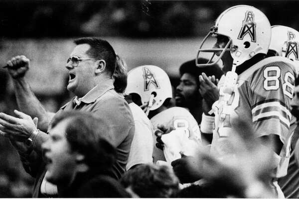 "December 4, 1977: Houston Oilers head coach O.A. ""Bum"" Phillips cheers the defense as they hold the line on Denver Broncos  second possession of the game."