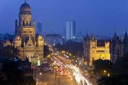 View over Victoria terminus or Chhatrapati Shivaji terminus (CST) and central Mumbai at dusk Mumbai India