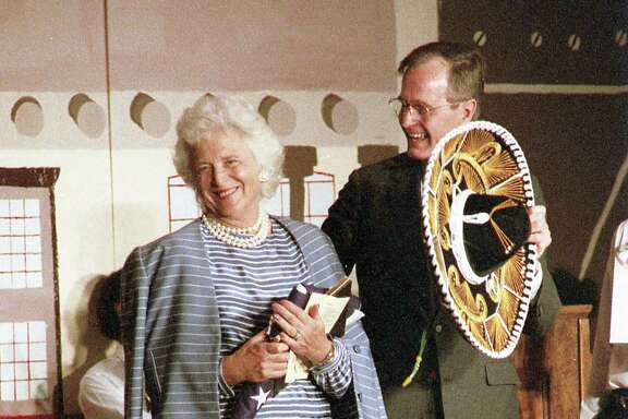 Vice President George H.W. Bush and wife Barbara Bush at Hogg Middle School for a Cinco de Mayo event, May 5, 1987.