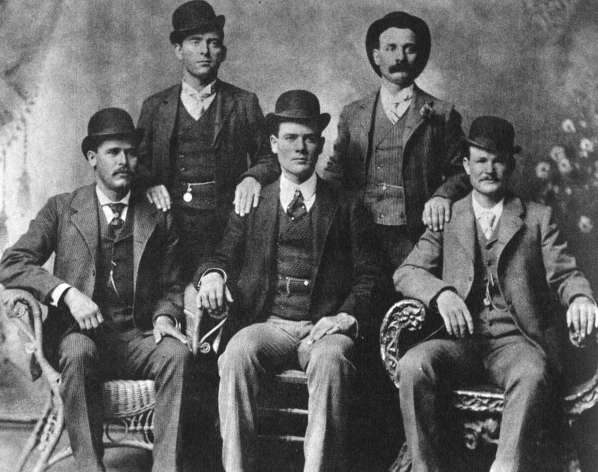 The Wild Bunch, American outlaw gang, 1901  Left to right, standing, William Carver (News Carver), Harvey Logan (Kid Curry); sitting, Harry Longabaugh (Sundance Kid), Ben Kilpatrick (The Tall Texan), Robert LeRoy Parker (Butch Cassidy). The gang operated out of the Hole-in-the-Wall Pass in Wyoming, a notorious haunt of outlaw groups, between 1889 and 1901 robbing trains and banks across the West. Their activities came to an end in 1901. Butch Cassidy and the Sundance Kid emigrated to South America (they are said to have been killed by Bolivian police after a robbery in 1908), Carver was killed in a shootout with lawmen, and Kilpatrick was captured in Tennessee and sentenced to 20 years in jail. Kid Curry, the most notorious member of the gang in terms of the number of people he killed, was shot and killed in a gunfight with lawmen in Colorado in 1904. Kilpatrick was released from prison in 1911 but was shot and killed the following year while robbing a train near Sanderson, Texas. (Photo by The Print Collector/Print Collector/Getty Images)