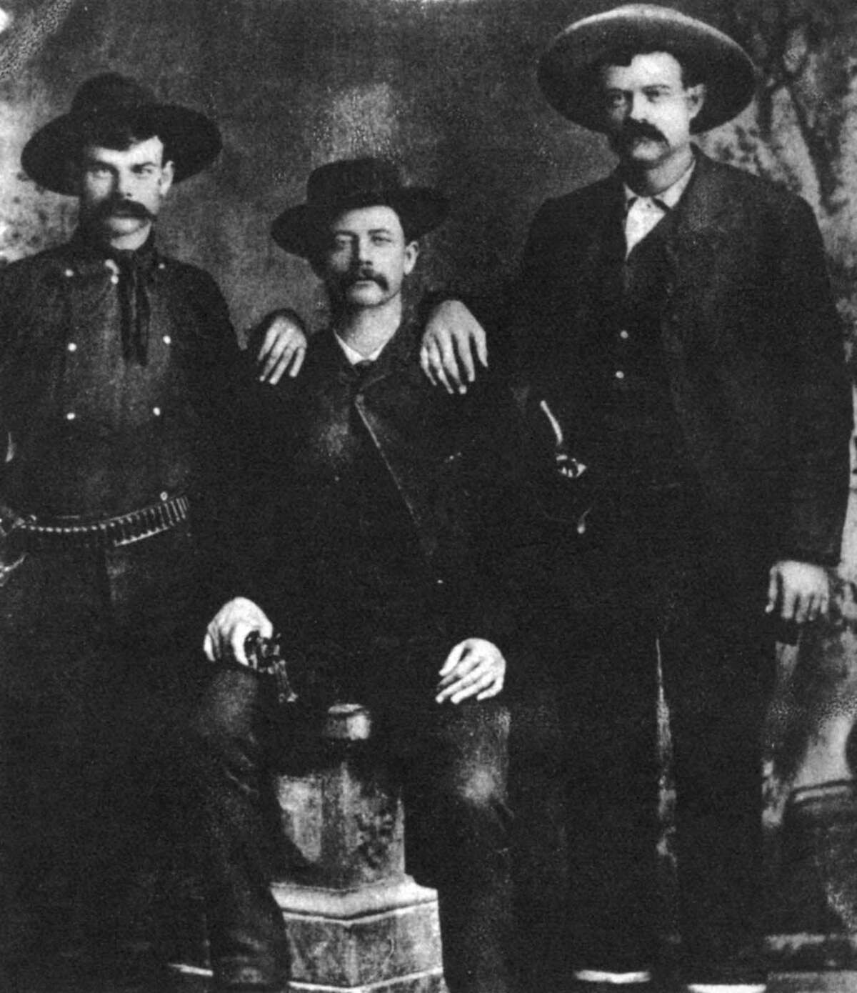 A disputed photograph of the train robber and outlaw Sam Bass, c1877-1878 (1954). Bass is alleged to be the seated figure in the center. He led a gang that held up a Union Pacific train at Big Springs, Nebraska, on 18th September 1877, stealing $60,000. He was shot in an ambush at Round Rock, Texas on July 19, 1878 while scouting the area before a planned bank robbery and died from his wounds the following day. A print from the Pictorial History of the Wild West, by James D Horan and Paul Sann, Spring Books, London, 1954.