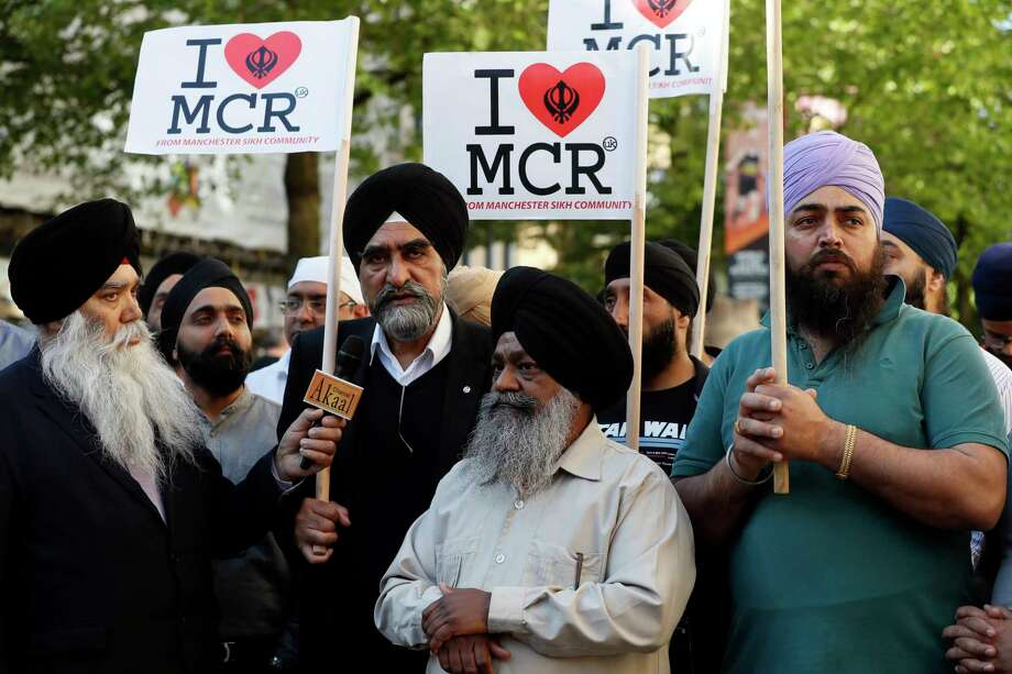 Members of the Manchester Sikh Community attend a vigil in Albert Square, Manchester, England, Tuesday May 23, 2017, the day after the suicide attack at an Ariana Grande concert that left 22 people dead as it ended on Monday night. Photo: Kirsty Wigglesworth, AP / Copyright 2017 The Associated Press. All rights reserved.