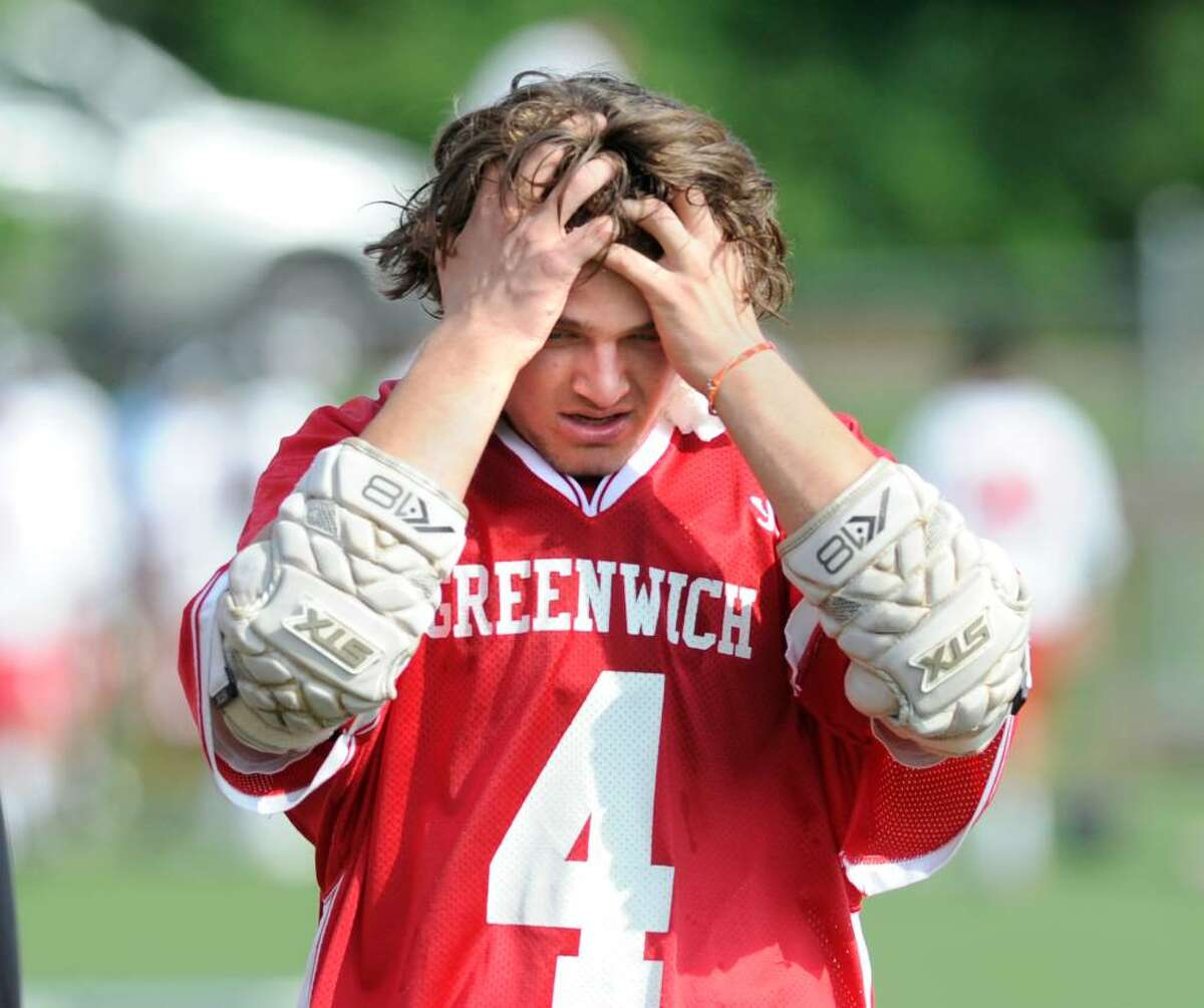 Adam Sands of Greenwich High School, puts his hands to his head at the half with his team down 5-3 against Fairfield Prep, Saturday, June 5, 2010, during the 2010 Boys Lacrosse State Class L Quarterfinals at Fairfield Prep. Prep went on to win the game with a final score of 9-7 and advance to the semi-final round.