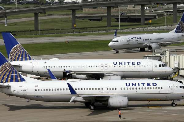 """FILE - In this July 8, 2015, file photo, United Airlines planes are seen on the tarmac at the George Bush Intercontinental Airport in Houston. United Airlines says a disruptive passenger on a flight from Shanghai to New Jersey was asked to get off, resulting in an unscheduled stop in San Francisco and an arrival delayed by eight hours. Videos on social media showed an unidentified elderly man wearing a red """"Make America Great Again"""" cap heatedly insisting that he was entitled to a seat and yelling at fellow passengers. (AP Photo/David J. Phillip, File)"""