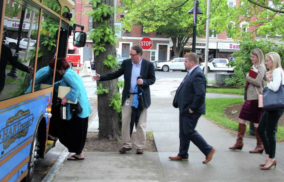 Danbury business leaders and CTNext board members get on a trolley to tour the downtown area of Danbury, Conn., on Monday, May 22, 2017. Danbury is one of seven finalists to earn an innovation grant from CTNext. Photo: Chris Bosak / Hearst Connecticut Media / The News-Times