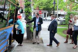Danbury business leaders and CTNext board members get on a trolley to tour the downtown area of Danbury, Conn., on Monday, May 22, 2017. Danbury is one of seven finalists to earn an innovation grant from CTNext.