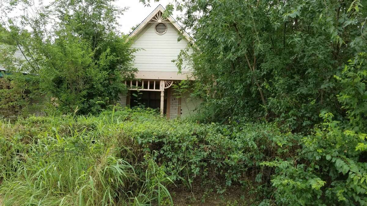 The 100 block of Ridgemore Lane, located off Gale Street, where a body in a coffin was found on Monday, May 22.Click through this gallery to see a list of Texas residences still haunted by tragedy.