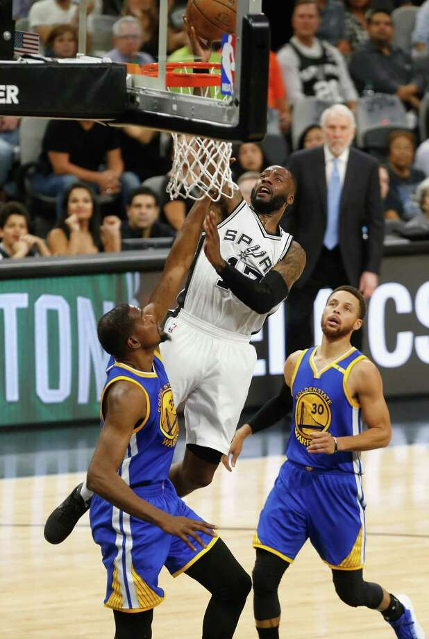 Jonathon Simmons of the San Antonio Spurs drives to the basket against Kevin Durant of the Golden State Warriors in the first half during Game Four of the 2017 NBA Western Conference Finals at AT&T Center on Monday. Though the Spurs were swept in the series, they are still winners. Photo: Ronald Cortes /Getty Images / 2017 Getty Images