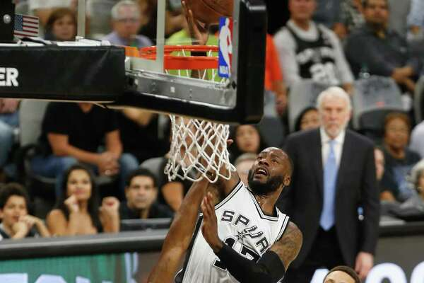 Jonathon Simmons of the San Antonio Spurs drives to the basket against Kevin Durant of the Golden State Warriors in the first half during Game Four of the 2017 NBA Western Conference Finals at AT&T Center on Monday. Though the Spurs were swept in the series, they are still winners.