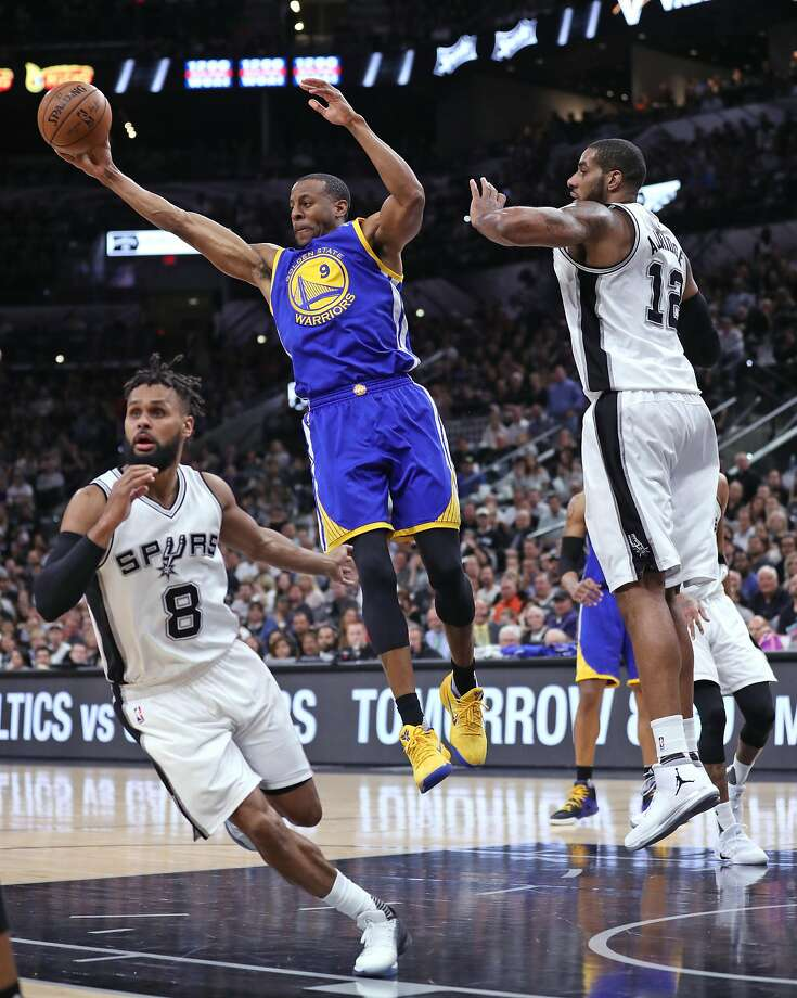 The Warriors' Andre Iguodala hauls in a rebound against the Spurs during Game 4 of NBA Western Conference finals. Photo: Scott Strazzante, The Chronicle