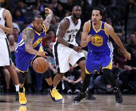 Golden State Warriors' Andre Iguodala and Shaun Livingston against San Antonio Spurs during Game 4 of NBA Western Conference Finals at AT&T Center in San Antonio, Texas, on Monday, May 22, 2017.