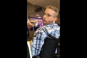 A screenshot of cell phone footage shows a man known only as Mike inside a Nevada airport in mid-May 2017. The man behind the cell phone, Hector Torres, recorded Mike's racist and vulgar tirade. 