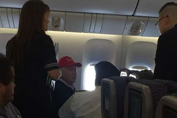"A United Airlines flight from Shanghai to Newark was forced to land at San Francisco International Airport after a passenger wearing a ""Make America Great Again"" hat caused a disturbance, officials said."