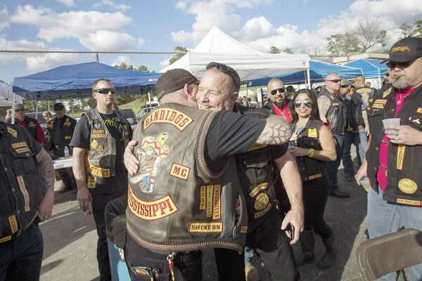 Jeff Pike, former Bandidos Motorcycle Club president, center-right, is greeted by members at the group's 50th anniversary party Saturday, March 12, 2016, in Kingwood. ( Jon Shapley / Houston Chronicle )