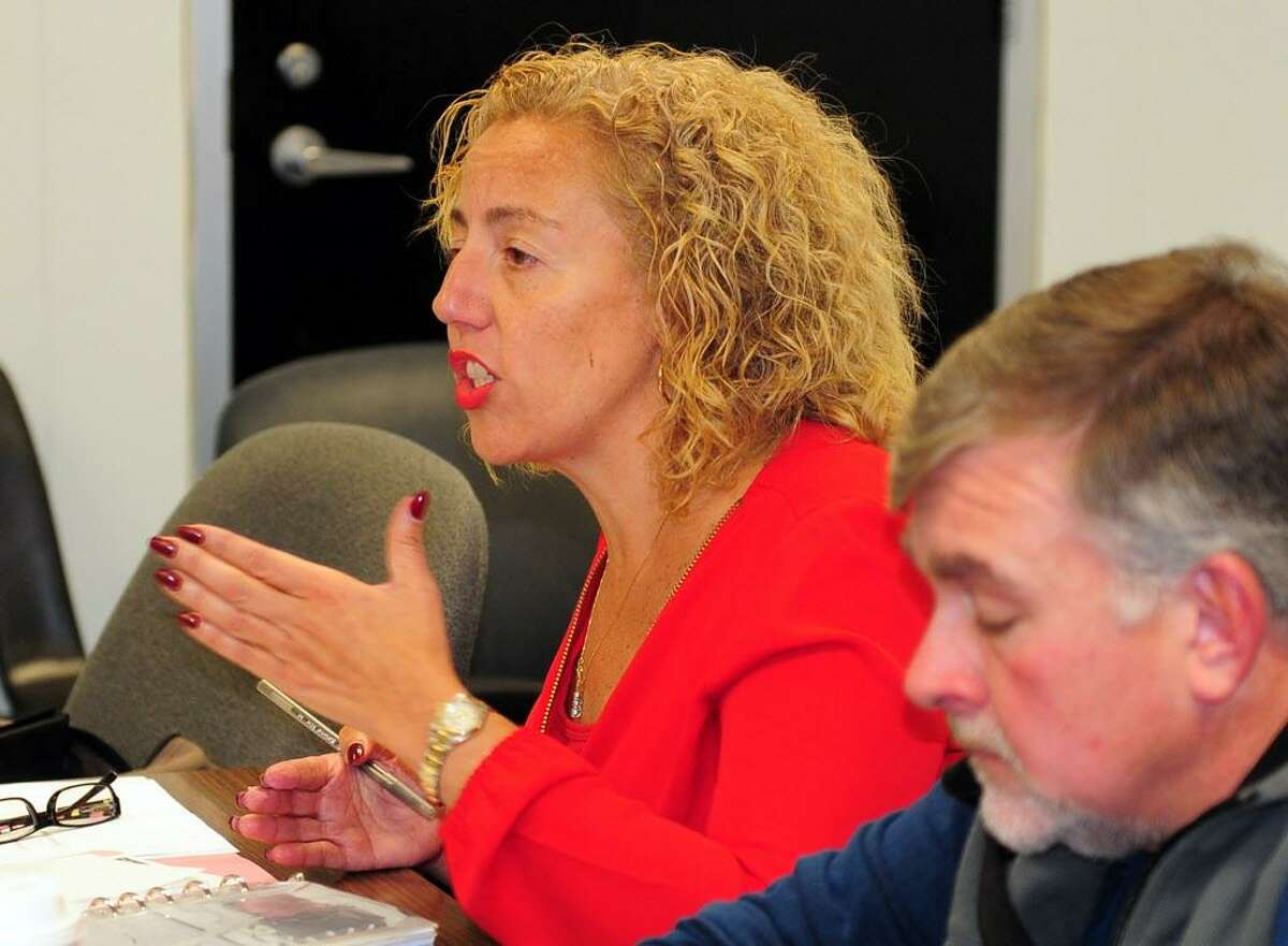 Bridgeport School Board member Annette Segarra-Negron attends a special meeting at Bridgeport City Hall building in Bridgeport, Conn., on Wednesday Oct. 12, 2016. Segarra-Negron was appointed to the board by Mayor Joe Ganim. The full board held the meeting in wake of Tuesday night's illegal meeting with one faction of the board held at Geraldine Johnson School.
