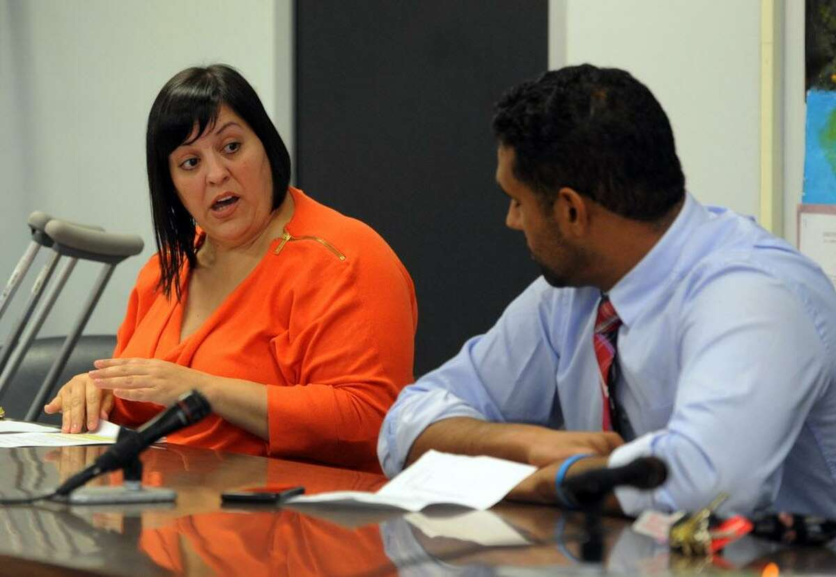 Bridgeport School Board member Maria Pereira, left, talks to Chairman Dennis Bradley during a special meeting at Bridgeport City Hall building in Bridgeport, Conn., on Wednesday Oct. 12, 2016. The full board held the meeting in wake of Tuesday night's illegal meeting with one faction of the board held at Geraldine Johnson School.