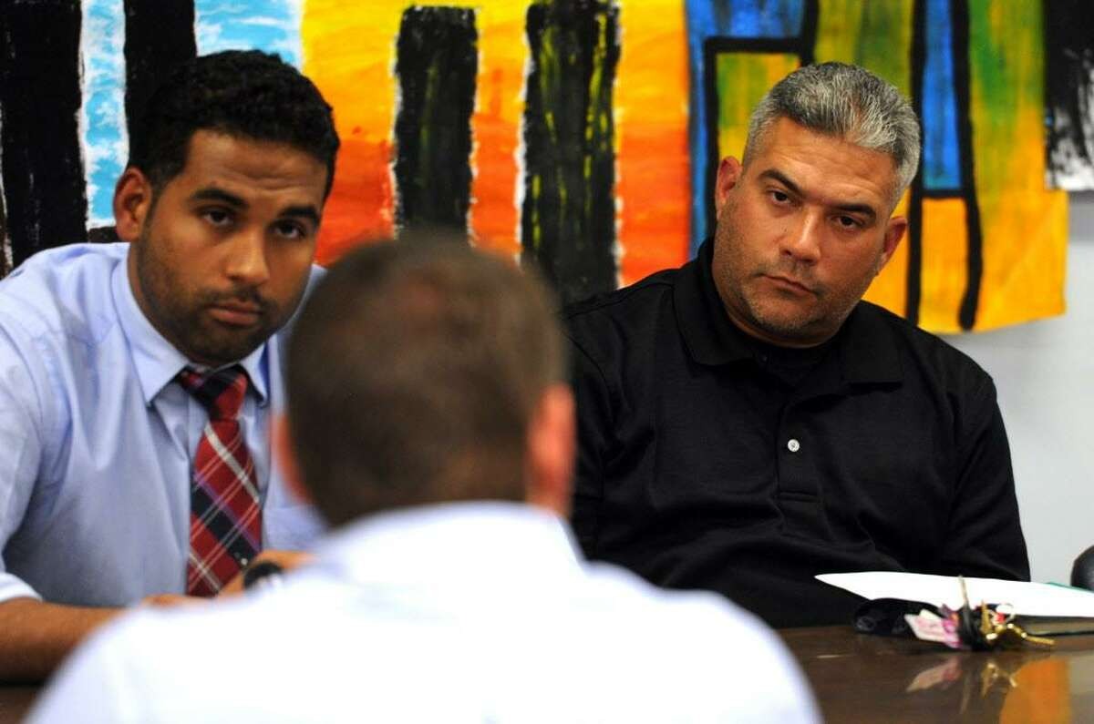 Bridgeport School Board member Rafael Fonseca, Jr., right, attends a special meeting at Bridgeport City Hall building in Bridgeport, Conn., on Wednesday Oct. 12, 2016. Fonseca, Jr. was appointed to the board by Mayor Joe Ganim. At left is Board Chairman Dennis Bradley. The full board held the meeting in wake of Tuesday night's illegal meeting with one faction of the board held at Geraldine Johnson School.