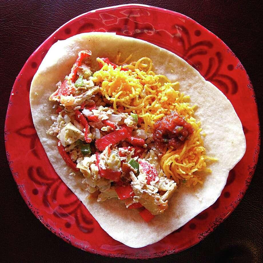 Chilaquiles taco on a handmade flour tortilla from Taquería Aguascalientes. Photo: Mike Sutter /San Antonio Express-News