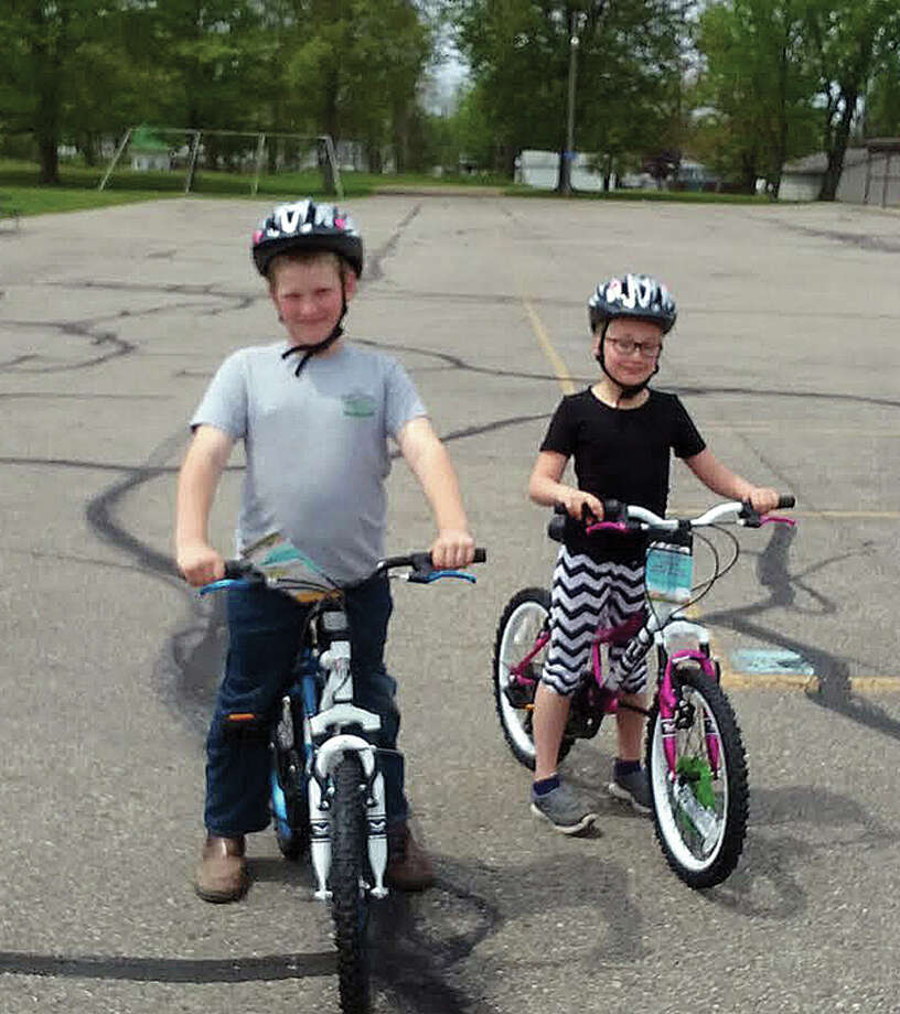 Two students, Annie Bowman and Axel Schuette, were recipients of brand new bicycles from Scheurer Hospital. (Submitted Photo: Submitted Photo