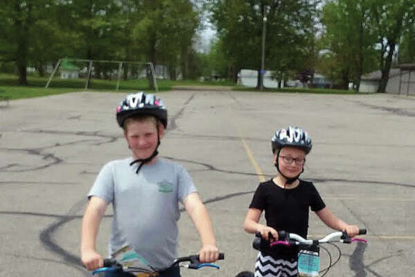 Two students, Annie Bowman and Axel Schuette, were recipients of brand new bicycles from Scheurer Hospital. (Submitted