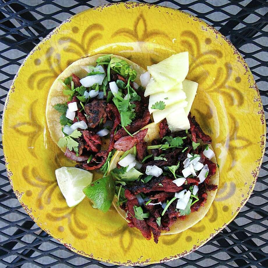 Al pastor tacos on mini corn tortillas from Marioli Meals to Go-urmet. Photo: Mike Sutter /San Antonio Express-News