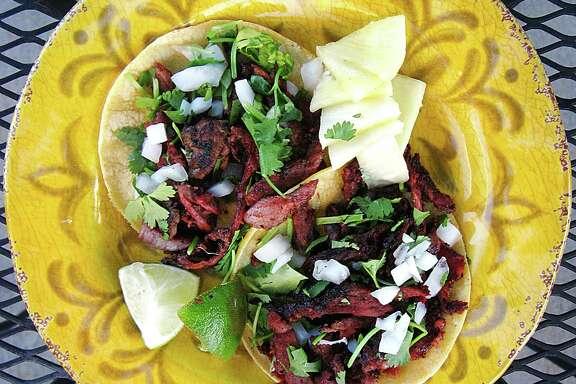 Al pastor tacos on mini corn tortillas from Marioli Meals to Go-urmet.