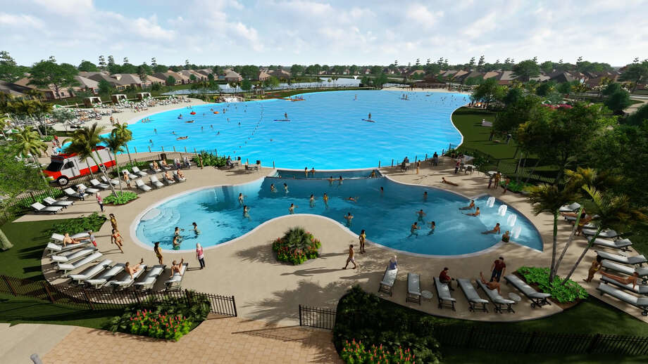 Houston's first-ever Crystal Lagoon opened earlier this year in the Balmoral neighborhood in Humble. It includes a sand volleyball court and lighted tennis court and a boardwalk. Photo: Courtesy Of Land Tejas