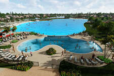 Houston's first-ever Crystal Lagoon is on its way to the Bayou City in the Balmoral neighborhood in Humble. A sand volleyball court and lighted tennis and a boardwalk circling the lagoon is also included.