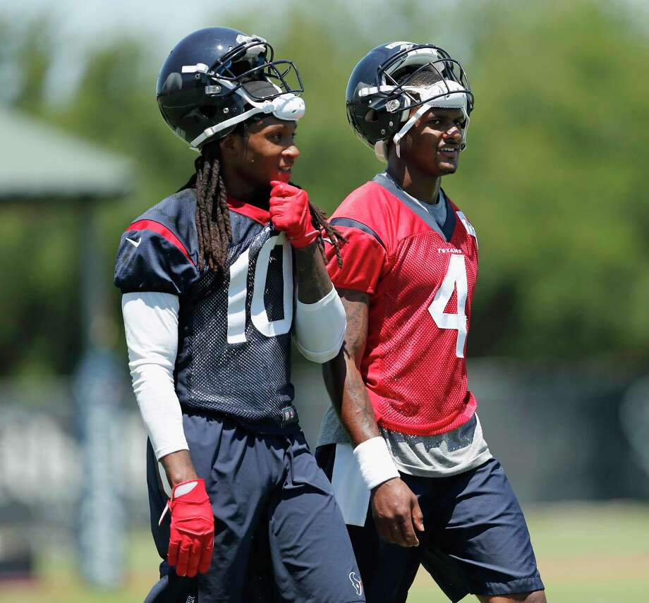 Houston Texans wide receiver DeAndre Hopkins (10) and quarterback Deshaun Watson (4) walk to the sideline during the Houston Texans OTAs at the Methodist Training Center in Houston, TX on Tuesday, May 23, 2017. Photo: Tim Warner, For The Chronicle / Houston Chronicle