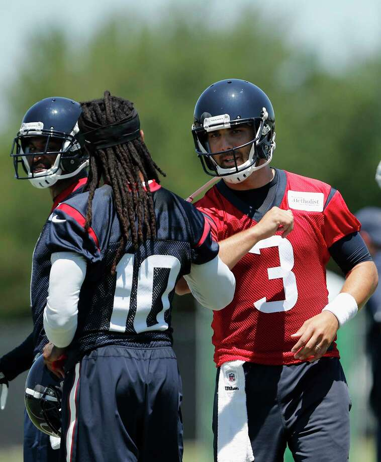 Houston Texans quarterback Tom Savage (3) talks with wide receiver DeAndre Hopkins (10) during the Houston Texans OTAs at the Methodist Training Center in Houston, TX on Tuesday, May 23, 2017. Photo: Tim Warner, For The Chronicle / Houston Chronicle
