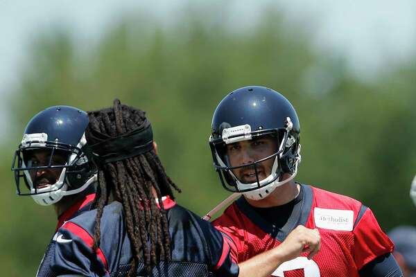 Houston Texans quarterback Tom Savage (3) talks with wide receiver DeAndre Hopkins (10) during the Houston Texans OTAs at the Methodist Training Center in Houston, TX on Tuesday, May 23, 2017.