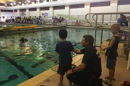Katy Aquatics' annual Make A Splash attracted 500 attendees May 13. Katy Aquatics partnered with Texas Children's Hospital West Campus to host the free family water safety event at Cinco Ranch High School where organizers gave more than 170 swim lessons to children and 100 families completed station cards with four or more activities. Partners include Fort Bend EMS and the Willowfork Fire Department.