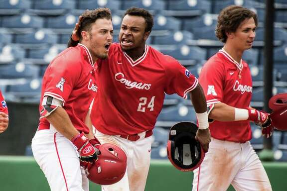 Grayson Padgett celebrates with Corey Julks (24) after his eighth-inning pinch-hit home run that put the University of Houston ahead of Memphis for good in the Cougars' opening round win in the American Athletic Conference.