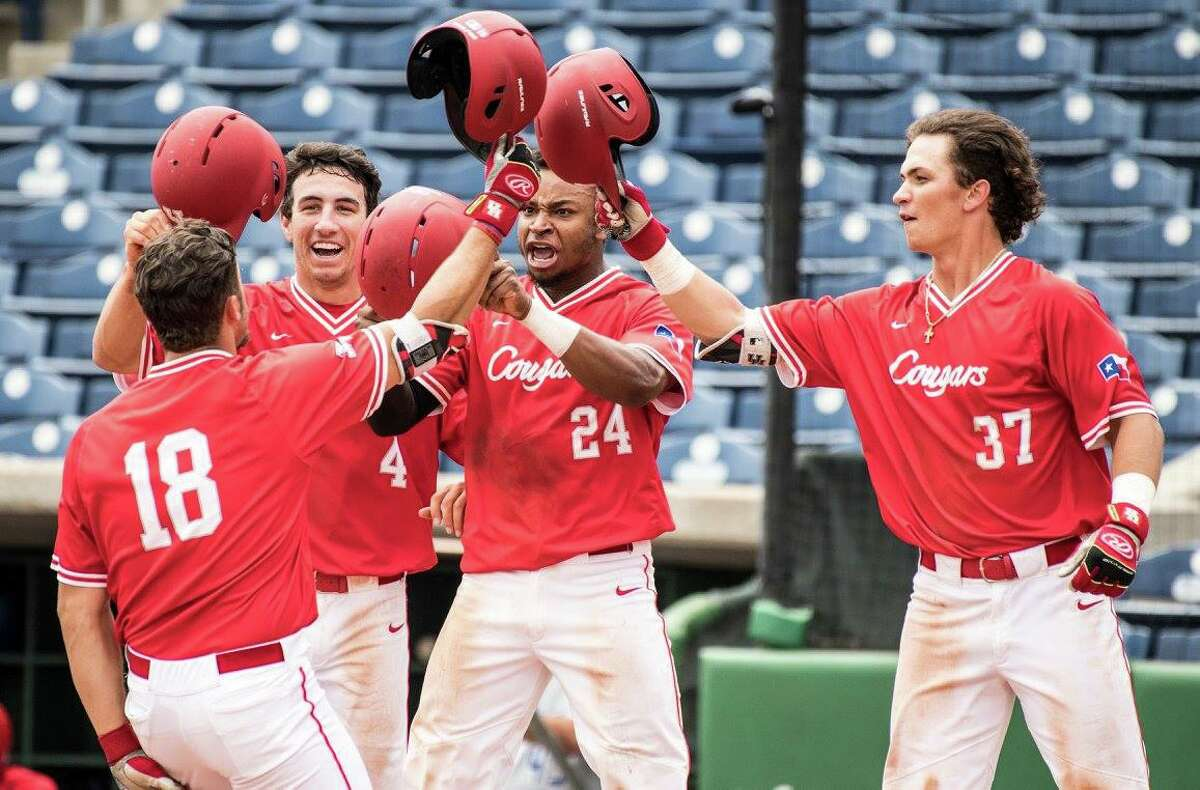 Grayson Padgett is greeted at home plate by his teammates after his eighth-inning pinch-hit home run that put the University of Houston ahead of Memphis for good in the Cougars' opening round win in the American Athletic Conference.