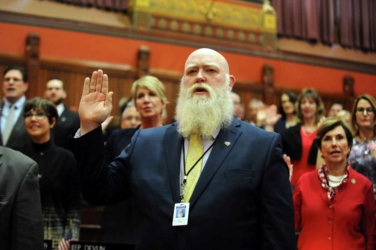 Rep. William Buckbee, R, New Milford) gets sworn in during the opening day of the 2017 legislative session.