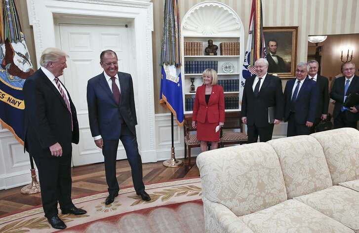 """In an image provided by the Russian Foreign Ministry, President Donald Trump meets with Sergey Lavrov, second left, the Russian foreign minister, ambassador Sergey Kislyak, fourth right, and other officials in the Oval Office, at the White House in Washington, May 10. At this meeting, Trump called James Comey """"a real nut job"""" and said that firing the FBI director the day before had relieved great pressure on himself, according to a document summarizing the meeting."""