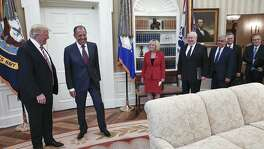 "In an image provided by the Russian Foreign Ministry, President Donald Trump meets with Sergey Lavrov, second left, the Russian foreign minister, ambassador Sergey Kislyak, fourth right, and other officials in the Oval Office, at the White House in Washington, May 10. At this meeting, Trump called James Comey ""a real nut job"" and said that firing the FBI director the day before had relieved great pressure on himself, according to a document summarizing the meeting."
