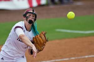 Texas A&M pitcher Samantha Show (1) throws out Texas State's Ariel Ortiz  after a bunt during a college softball game in College Station, Texas. (Timothy Hurst/College Station Eagle via AP)