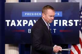 "WASHINGTON, DC - MAY 23:  Office of Management and Budget Director Mick Mulvaney arrives for a news conference to discuss the Trump Administration's proposed FY2017 federal budget in the Brady Press Briefing Room at the White House May 23, 2017 in Washington, DC. Calling it a ""New Foundation for American Greatness,"" the $4.1 trillion budget for would cut programs for the poor, including health care, food stamps, student loans and disability payments while offering big tax cuts for the wealthy.  (Photo by Chip Somodevilla/Getty Images)"