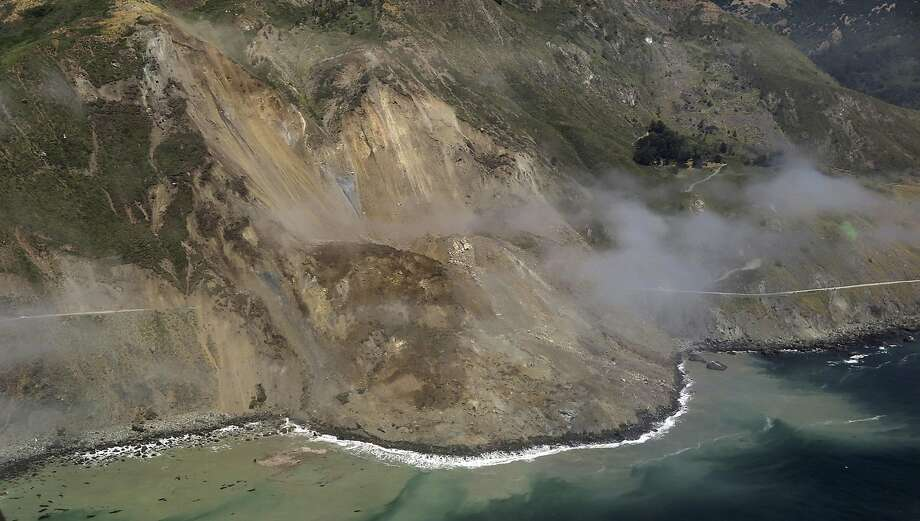 A stretch of Highway 1 near the southern end of Big Sur is covered by dirt and rock after a hillside gave way Saturday, causing the the biggest landslide that locals can remember and adding to a season of woe in the famously scenic area. Photo: John Madonna, Associated Press