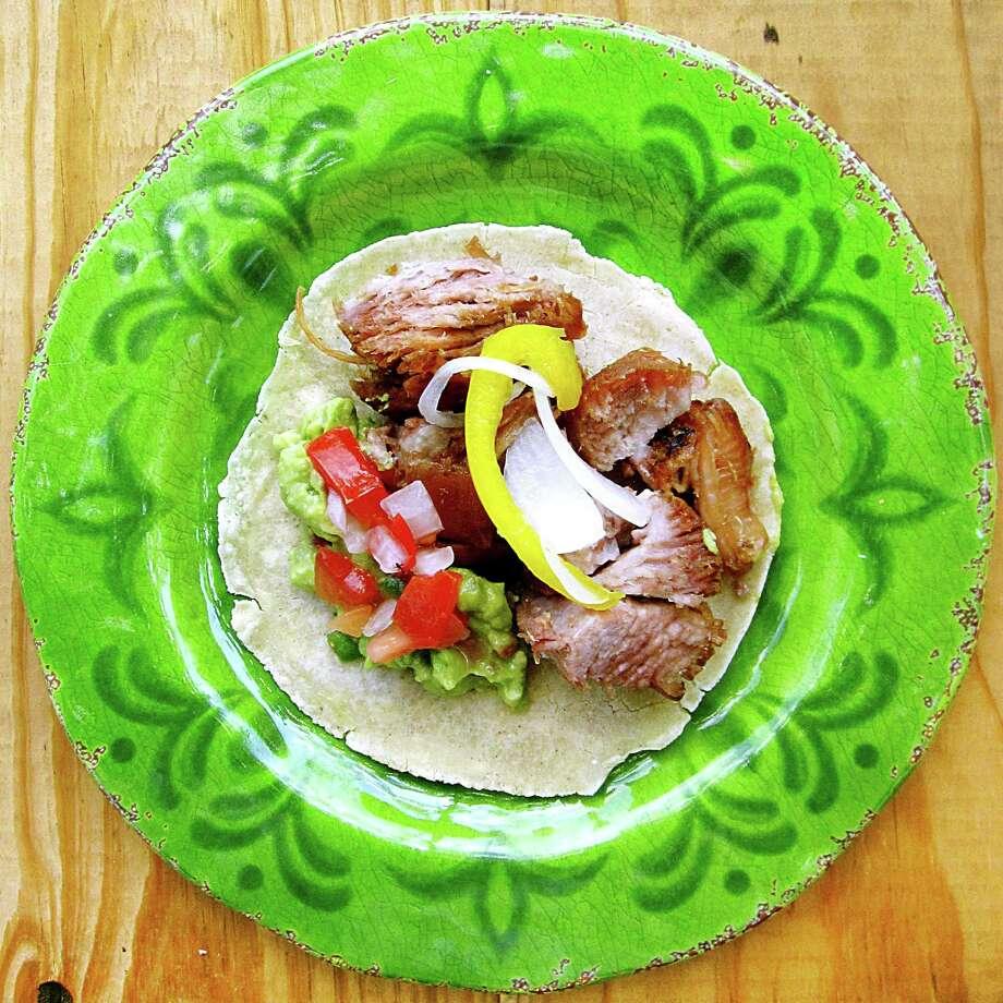 Carnitas taco with guacamole, pico de gallo and escabeche on a handmade corn tortilla from Carnitas Lonja. Photo: Mike Sutter /San Antonio Express-News