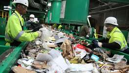 Classifiers work on removing non recyclable materials at Recology recycling plant on Pier 96 on Friday, May 19, 2017,  in San Francisco, Calif.