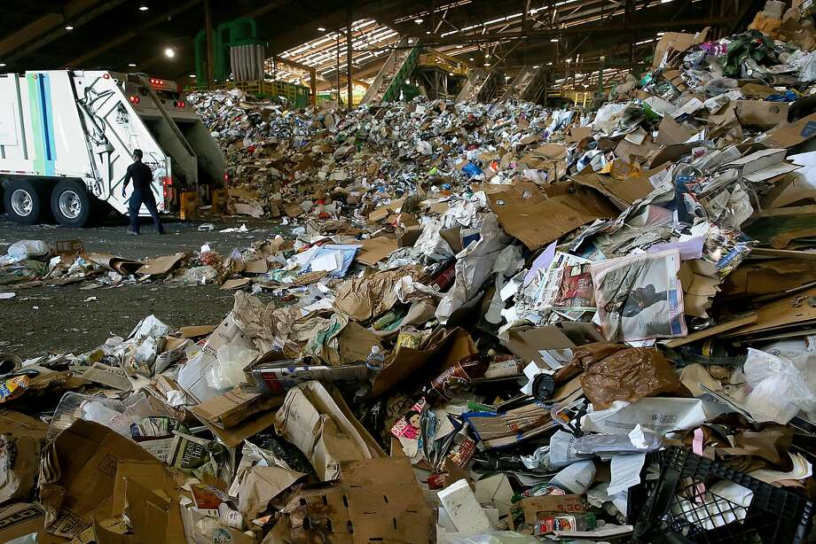 Trucks drop off recycled items at the Recology recycling plant at Pier 96 on May 19. Photo: Liz Hafalia, The Chronicle