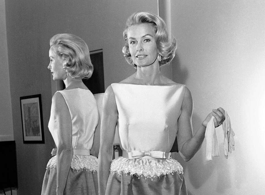 FILE - In this April 6, 1962 file photo, socialite-actress Dina Merrill models the gown she will wear at the Academy Awards presentation in Los Angeles. Merrill, the rebellious heiress who defied her super-rich parents to become an actress, died Monday, May 22, 2017, at age 93.  (AP Photo/Harold P. Matosian, File) Photo: Harold P. Matosian, STF / Copyright 2017 The Associated Press. All rights reserved.