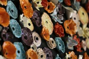 A detail of a wreath more than six-feet wide is seen outside the Buena Vista Horace Mann on Tuesday, May 23, 2017, in San Francisco, Calif. Students made the ceramic wreath that symbolizes a celebration of diversity.