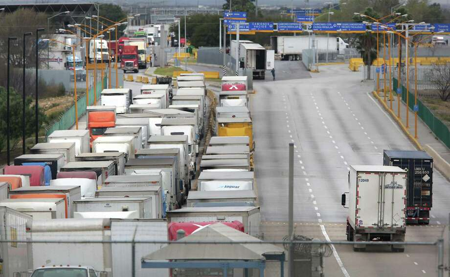 Trucks wait to enter the U.S. at the commercial-only World Trade Bridge. Currently only empty cargo trailers are allowed. Photo: San Antonio Express-News / File Photo / ©2017 San Antonio Express-News