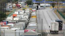 Trucks wait to enter the U.S. at the commercial-only World Trade Bridge. Currently only empty cargo trailers are allowed.